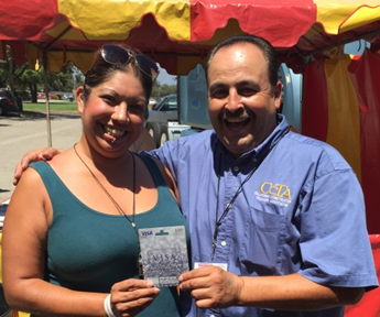 Beatrice Quesnot presented with gift card by WSTA's Victor Vasquez