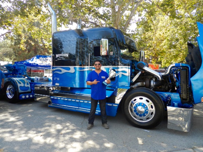 "Kelvin Monzon and his award winning 1999 Freightliner FLD, his first truck, a retired Old Dominion truck. This rig has pulled bottoms, end dumps and flatbeds before being turned into a tow truck. Kelvin said, ""It works in the dirt every day and takes trophies at shows.""  And yes, it's CARB compliant."